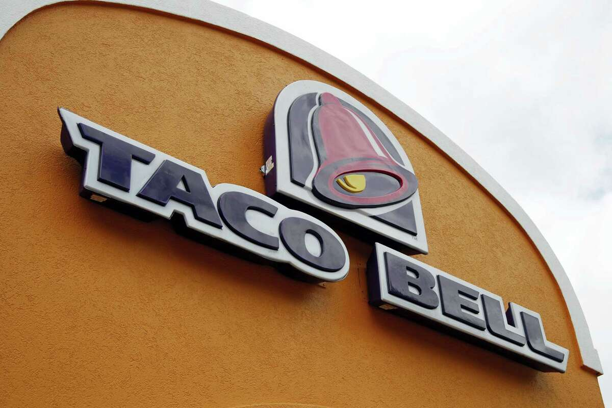 This Friday, May 23, 2014, file photo, shows the sign at a Taco Bell in Mount Lebanon, Pa. Taco Bell announced plans on Jan. 11, 2017, to go nationwide with its Naked Chicken Chalupa, a taco with a shell made out of fried chicken.