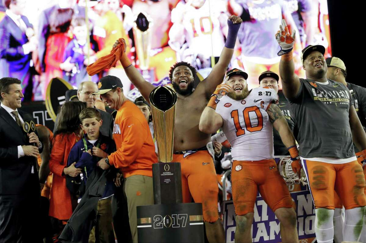 Clemson players celebrate after beating Alabama to win the national championship on Monday night.
