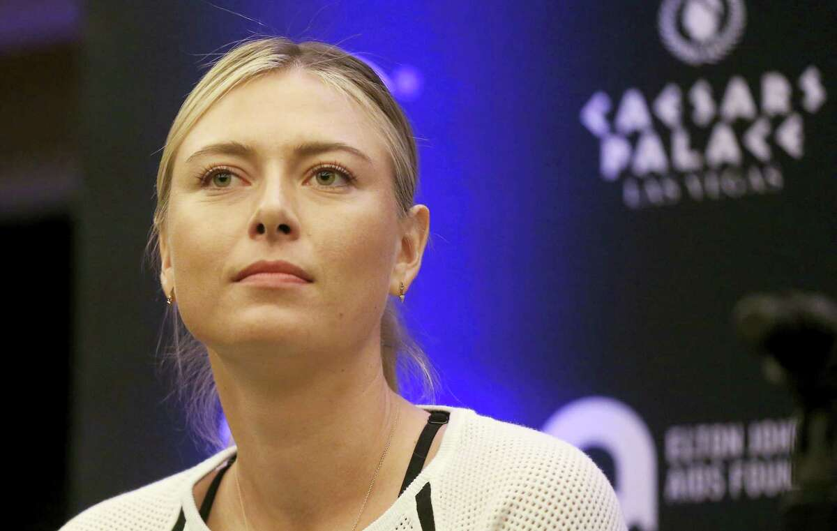 In this Oct. 10, 2016 photo, Maria Sharapova speaks to members of the media prior to a World Team Tennis exhibition in Las Vegas, U.S. Sharapova will return from her 15-month doping ban at a tournament in Germany in April.