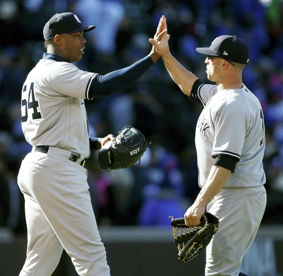 Yankees closer Aroldis Chapman, left, celebrates with Brett Gardner after the Yankees beat the Cubs Friday in Chicago. Photo: Nam Y. Huh — The Associated Press  / Copyright 2017 The Associated Press. All rights reserved.