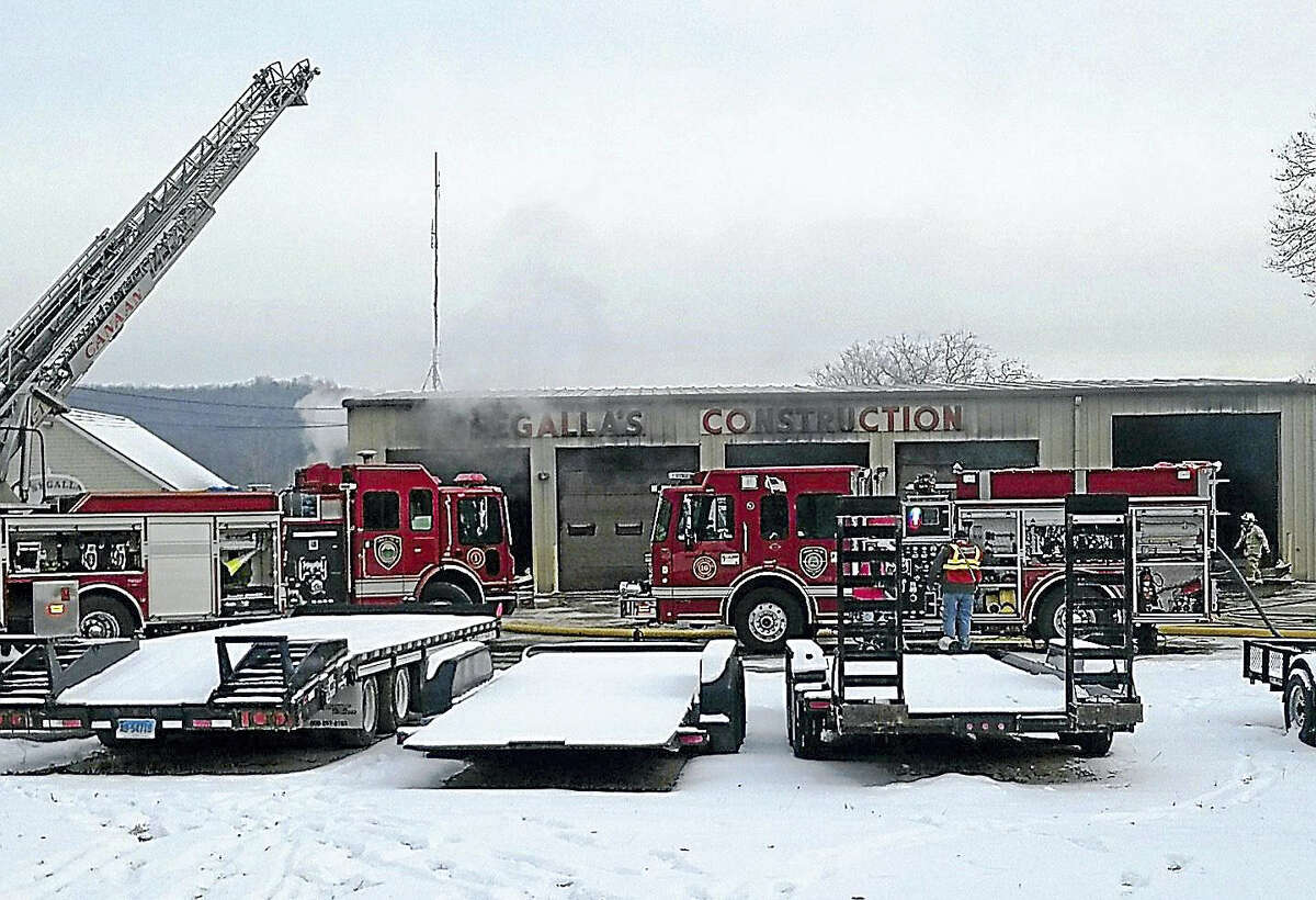 Crews from several area fire departments were battling a blaze Tuesday morning at Segalla's Construction on Allyndale Road in North Canaan.