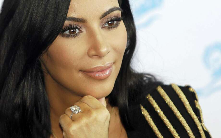 In this June 24, 2015 photo, American TV personality Kim Kardashian attends the Cannes Lions 2015 International Advertising Festival in Cannes, southern France. Paris police on Jan.9, 2017 say 16 people have been arrested over Kim Kardashian jewelry heist. Photo: AP Photo/Lionel Cironneau, File  / Copyright 2017 The Associated Press. All rights reserved.