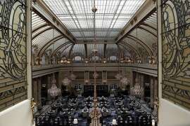 A view of the Garden Court with its leaded glass ceiling at the Palace Hotel in San Francisco, Calif., on Tuesday, August 15, 2017.  The Palace Hotel is refurbishing the classic glass and old ceiling at the famous 118 yr old Garden Court. The structure was retrofitted after severe damage during the 1989 earthquake.