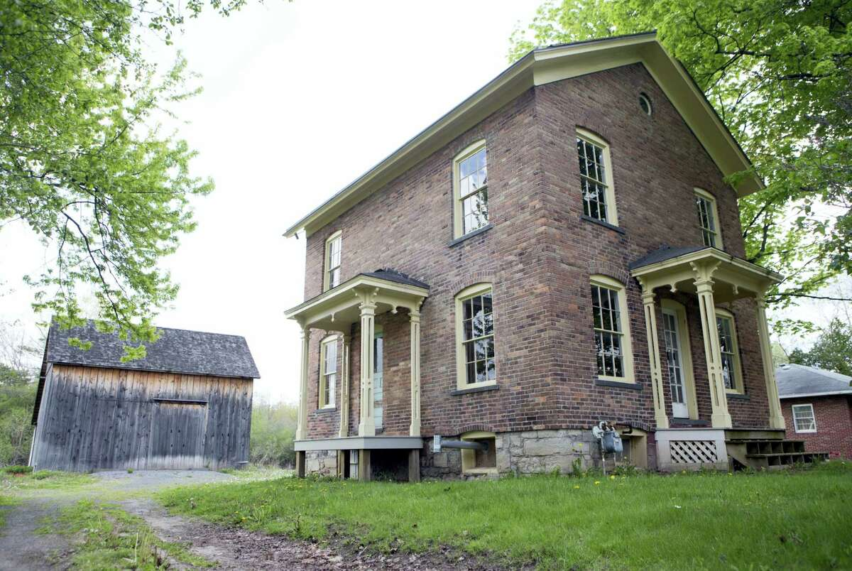 In this May 19, 2016 photo, the Harriet Tubman Residence is seen at the Harriet Tubman Home in Auburn, N.Y. New York lawmakers and federal parks officials are gathering in Washington, to formally establish the Harriet Tubman National Historical Park in New York. U.S. Interior Secretary Sally Jewell will preside over an official signing ceremony Jan. 10, 2017 that will make the park part of the National Park System.