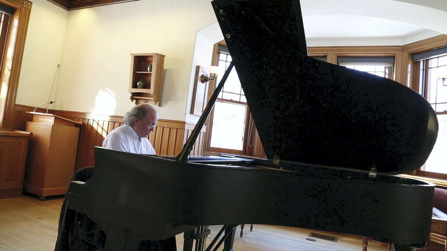 Contributed photoPianist Michael Ford at the piano. Photo: Digital First Media