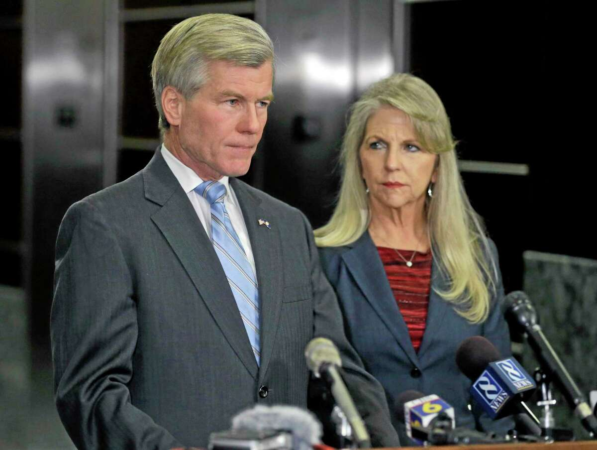 Steve Helber — The Associated Press Former Virginia Gov. Bob McDonnell makes a statement as his wife, Maureen, listens during a news conference in Richmond, Va.,