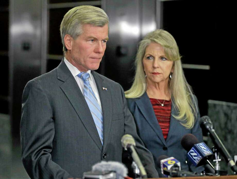 Steve Helber — The Associated Press  Former Virginia Gov. Bob McDonnell makes a statement as his wife, Maureen, listens during a news conference in Richmond, Va., Photo: AP / AP