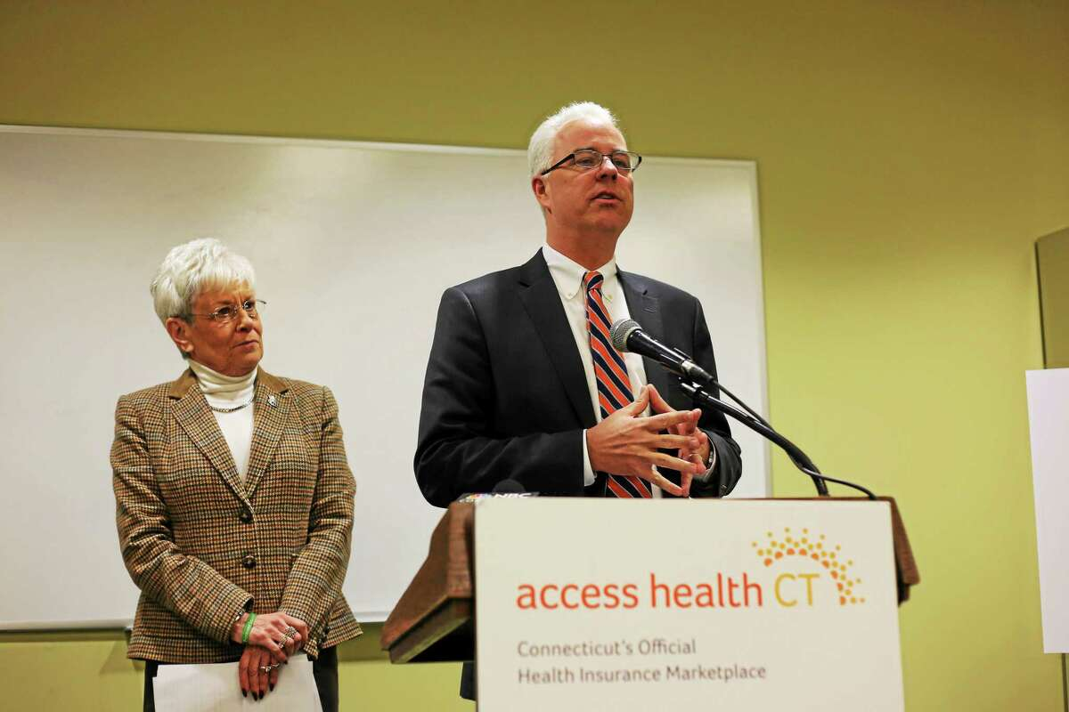 Access Health CT CEO Jim Wadleigh speaks at the podium while Lt. Gov. Nancy Wyman looks on.