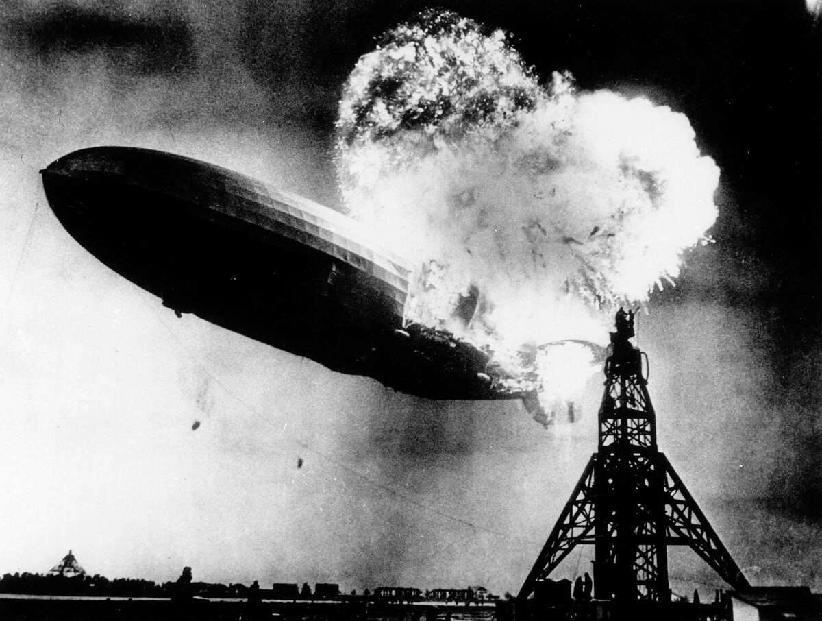 """This May 6, 1937, file photo, provided by the Philadelphia Public Ledger, was taken at almost the split second that the Hindenburg exploded over the Lakehurst Naval Air Station in Lakehurst, N.J. Only one person is left of the 62 passengers and crew who survived when the Hindenburg burst into flames 80 years ago Saturday, May 6, 2017. Werner Doehner was 8 years old when he boarded the zeppelin with his parents and older siblings after their vacation to Germany in 1937. The 88-year-old now living in Parachute, Colo., tells The Associated Press that the airship pitched as it tried to land in New Jersey and that """"suddenly the air was on fire."""""""