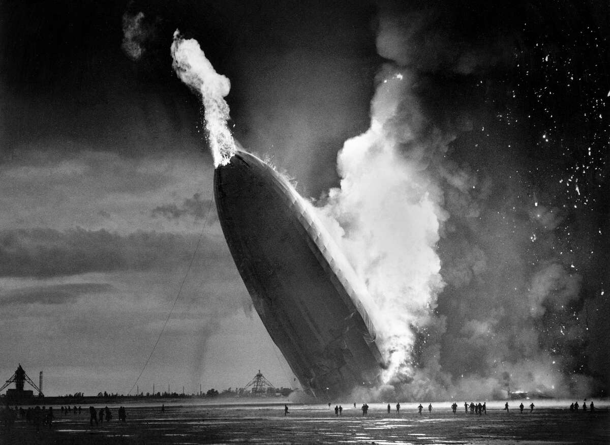 """In this May 6, 1937, file photo, the German dirigible Hindenburg crashes to earth in flames after exploding at the U.S. Naval Station in Lakehurst, N.J. Only one person is left of the 62 passengers and crew who survived when the Hindenburg burst into flames 80 years ago Saturday, May 6, 2017. Werner Doehner was 8 years old when he boarded the zeppelin with his parents and older siblings after their vacation to Germany in 1937. The 88-year-old now living in Parachute, Colo., tells The Associated Press that the airship pitched as it tried to land in New Jersey and that """"suddenly the air was on fire."""""""