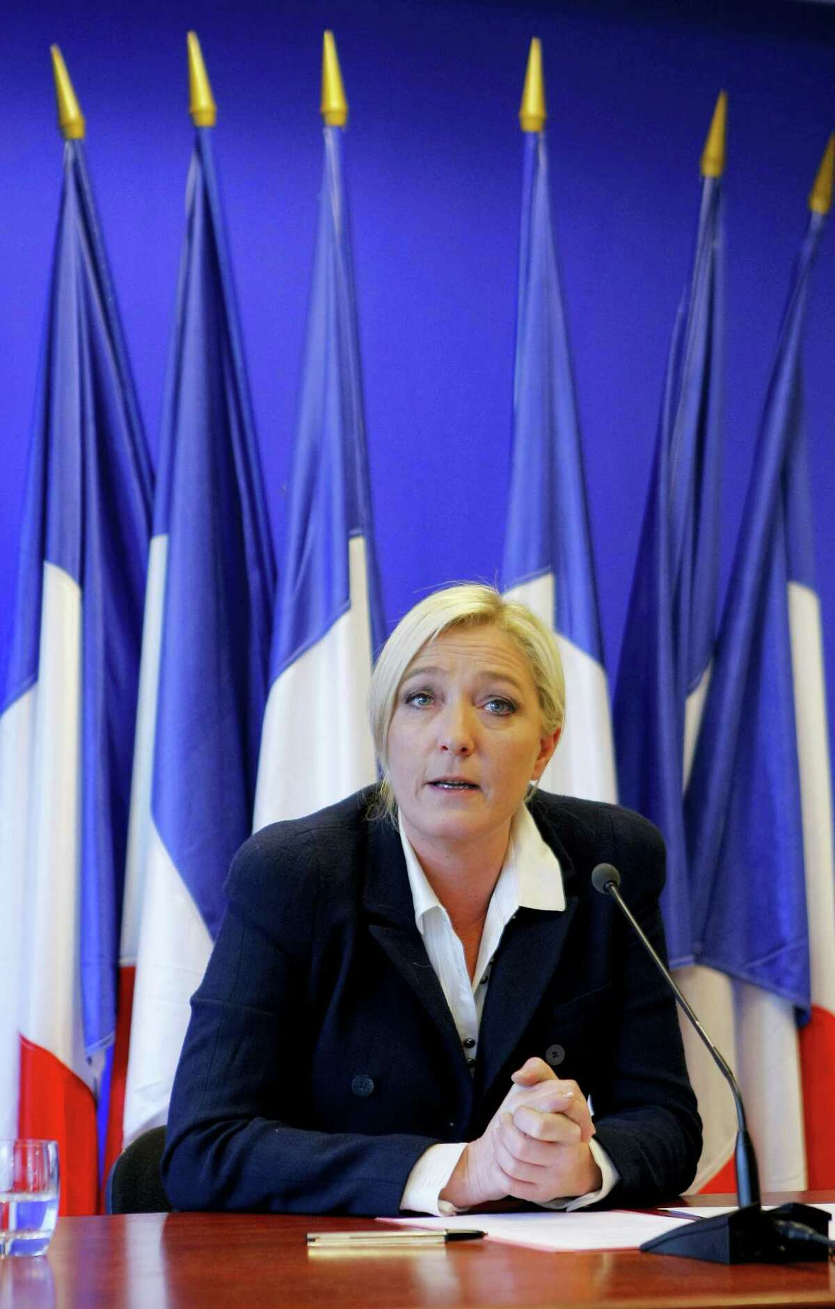 In this file photo dated Monday, March 21, 2011, Marine Le Pen, France's far-right National Front political party leader, speaks during a news conference the day after the first round of local elections at the party headquarters in Nanterre, near Paris. The seasoned campaigner Marine Le Pen seems to have polished her image ahead of the Sunday May 7, 2017, runoff presidential election, although her background and driving ambition has moulded her over many years of political campaigning. The 48-year-old mother of three Marine Le Pen portrays herself as the guardian of a disabused France, where citizens are losing their culture, and their sovereignty to the European Union.