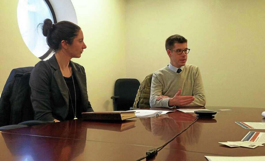 David McGuire, executive director of ACLU-CT, with Communications Director Meghan Smith at left, speaks to the New Haven Register Editorial Board about the organization's legislative priorities. Photo: Helen Bennett — New Haven Register