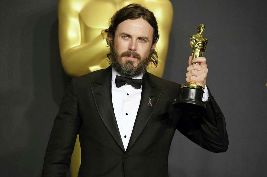 "Casey Affleck poses in the press room with the award for best actor in a leading role for ""Manchester by the Sea"" at the Oscars on Feb. 26, 2017 at the Dolby Theatre in Los Angeles. Photo: Photo By Jordan Strauss — Invision/AP  / 2017 Invision"