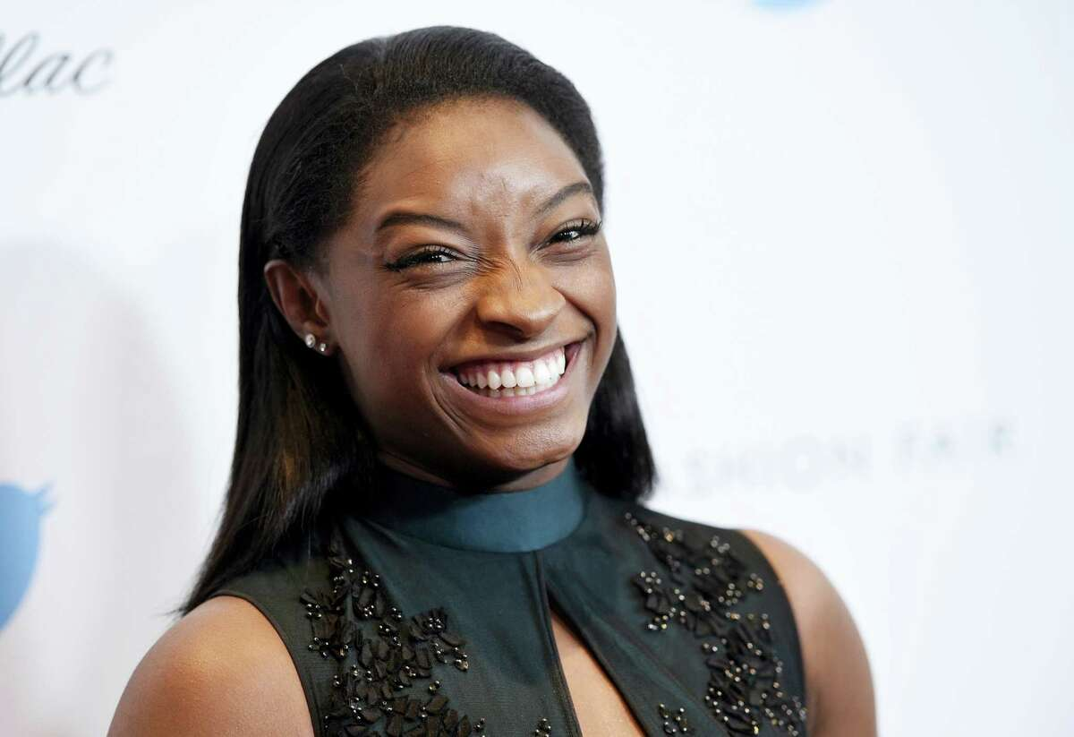 """In this Dec. 1, 2016 photo, Olympic gymnast Simone Biles poses at the 2016 EBONY Power 100 Gala at the Beverly Hilton in Beverly Hills, Calif. ABC announced March 1, 2017 that Biles is a cast member on the upcoming season of """"Dancing with the Stars."""""""