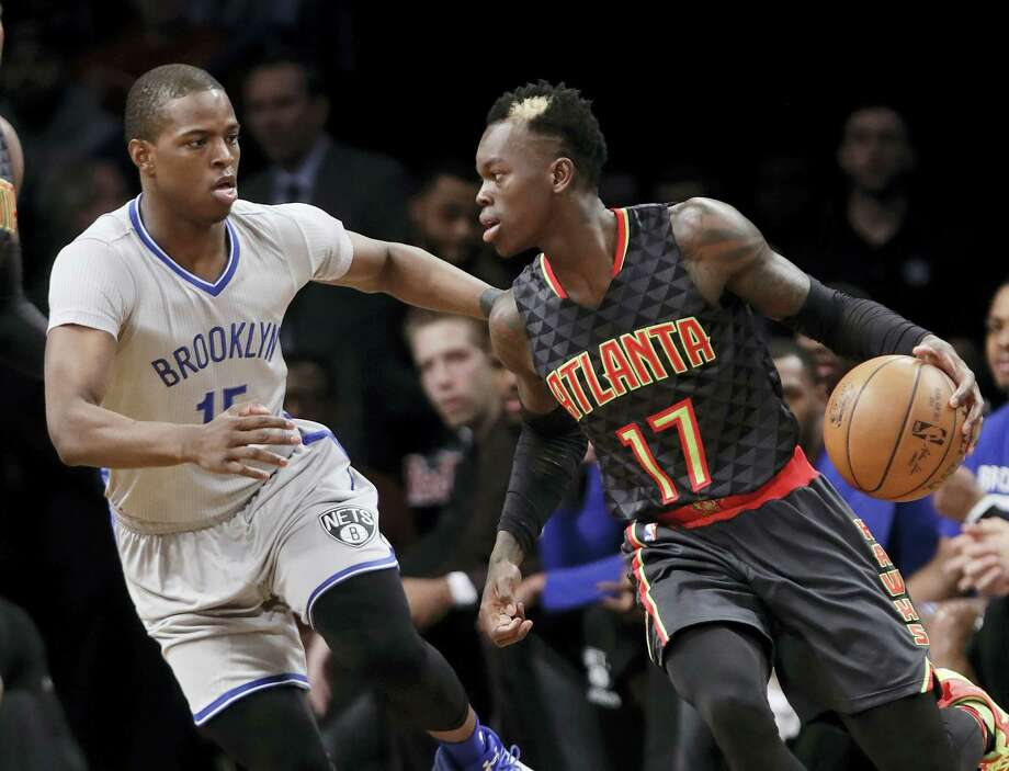 Brooklyn Nets' Isaiah Whitehead defends Atlanta Hawks' Dennis Schroder during the first half Tuesday. The Hawks won 117-97. Photo: FRANK FRANKLIN II — THE ASSOCIATED PRESS  / Copyright 2017 The Associated Press. All rights reserved.