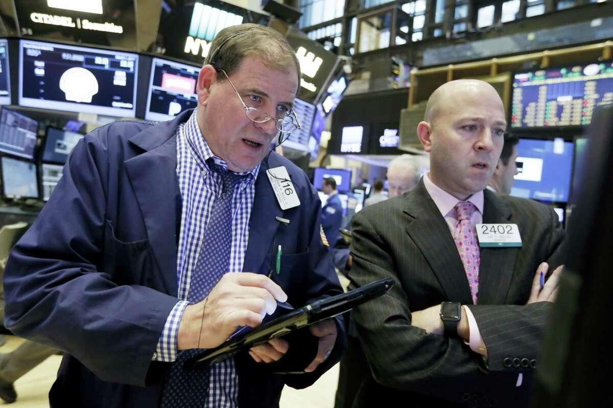 Jonathan Niles, left, and Jay Woods work on the floor of the New York Stock Exchange Wednesday.