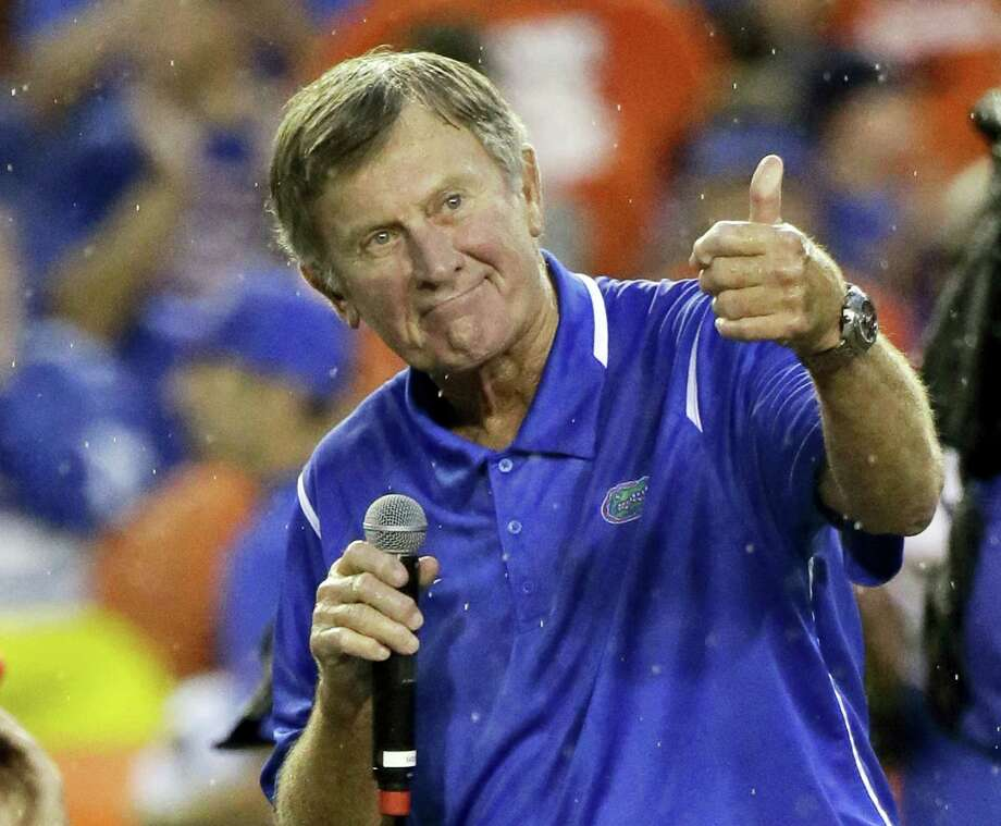 In this Sept. 3, 2016 photo, former Florida player and head coach Steve Spurrier makes remarks after he was honored during an NCAA college football game against Massachusetts in Gainesville, Fla. Peyton Manning and his Southeastern Conference nemesis, former Florida coach Spurrier, will go into the College Football Hall of Fame together. Spurrier built Florida into an SEC powerhouse from 1990-2001, winning six conference titles and the school's first national championship in 1996. Photo: AP Photo/John Raoux, File  / Copyright 2017 The Associated Press. All rights reserved.