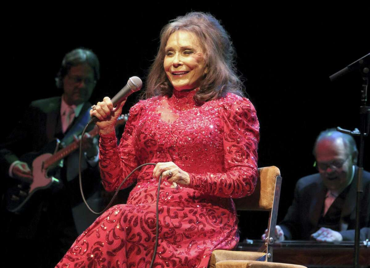 In this Aug. 28, 2016 file photo, Loretta Lynn performs in concert at the American Music Theater in Lancaster, Pa. A posting on country music legend Lynn's website says she has been hospitalized after having a stroke. The posting says Lynn was admitted into a Nashville hospital on Thursday night, May 4, 2017, after suffering the stroke at her home in Hurricane Mills, Tenn.