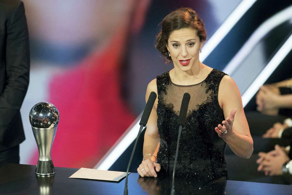 Carli Lloyd delivers a speech after winning the trophy for The Best FIFA Women's Player award.
