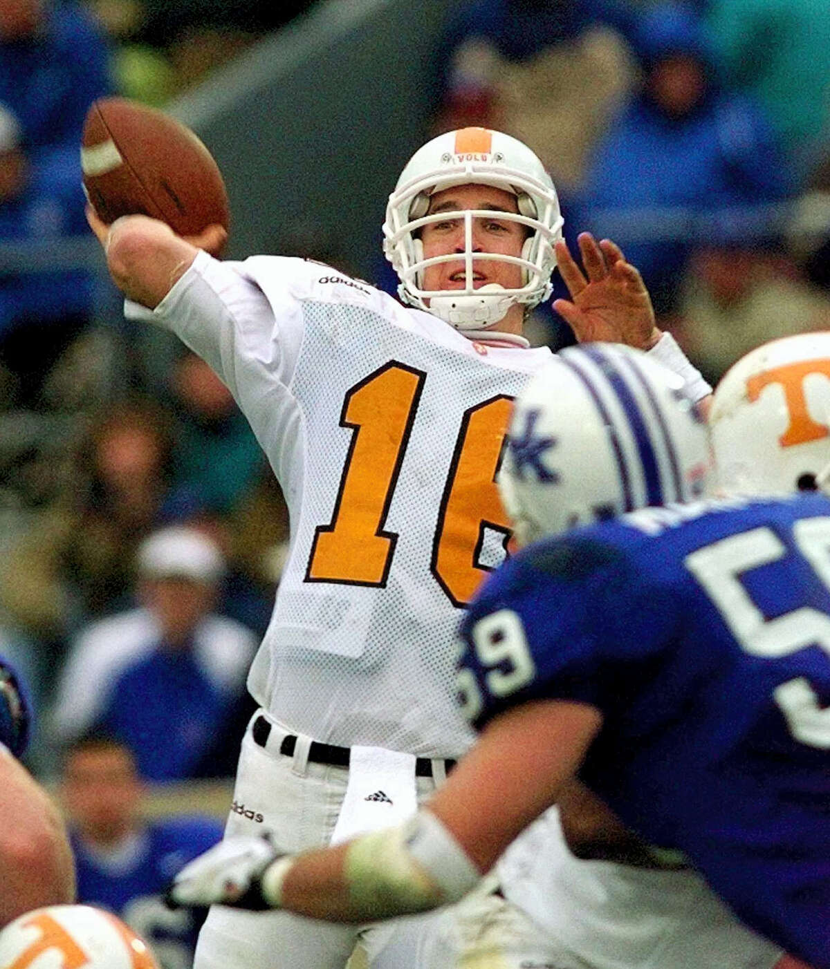 Tennessee quarterback Peyton Manning launches a pass. Manning and his Southeastern Conference nemesis, former Florida coach Steve Spurrier, will go into the College Football Hall of Fame together.