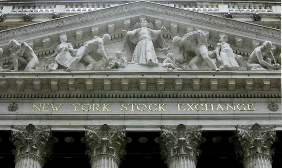 FILE - This Oct. 4, 2014, file photo, shows the facade of the New York Stock Exchange. Stocks are modestly higher in early trading on Wall Street, Friday, May 5, 2017, after the government reported a pickup in hiring in April. Photo: Richard Drew — The Associated Press File  / Copyright 2016 The Associated Press. All rights reserved. This material may not be published, broadcast, rewritten or redistribu