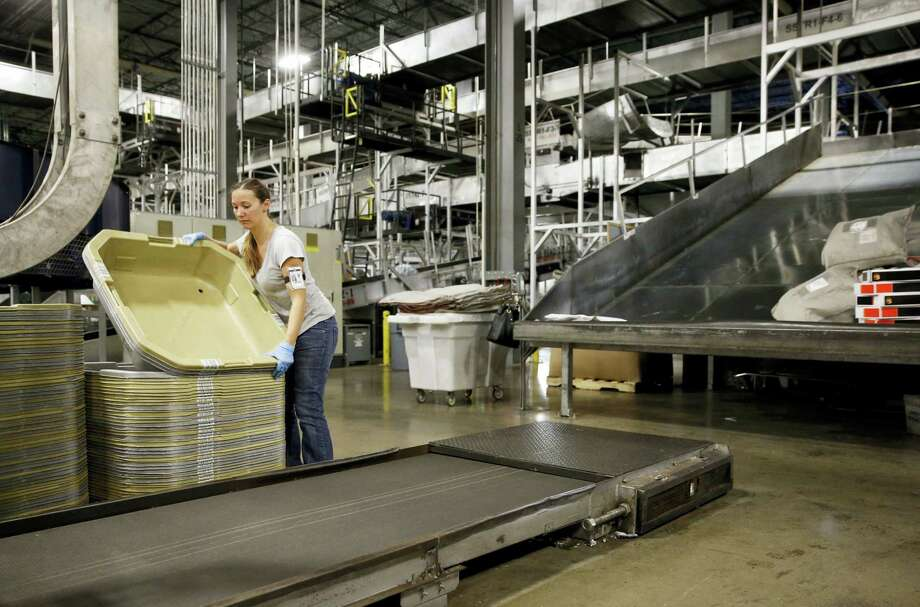 In this photo, a UPS employee works inside the company's Worldport hub in Louisville, Ky. On Friday the U.S. government issues the April jobs report. Photo: Patrick Semansky — The Associated Press  / Copyright 2017 The Associated Press. All rights reserved.