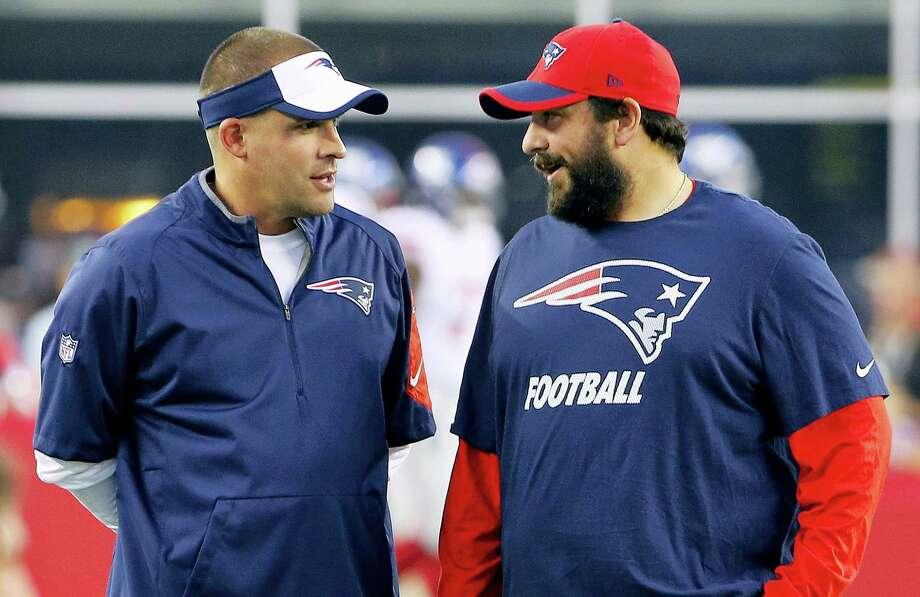 New England Patriots offensive coordinator Josh McDaniels, left, talks with defensive coordinator Matt Patricia. Photo: The Associated Press File Photo  / AP