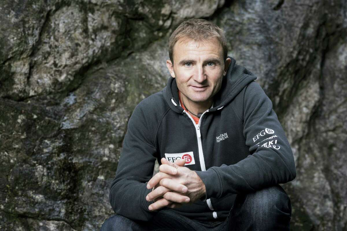 In this Sept. 11, 2015 photo, Swiss climber Ueli Steck poses for a photo at the foot of a climbing wall in Wilderswil, Canton of Berne, Switzerland. Expedition organizers say famed Swiss climber Ueli Steck was killed in a mountaineering accident near Mount Everest in Nepal.
