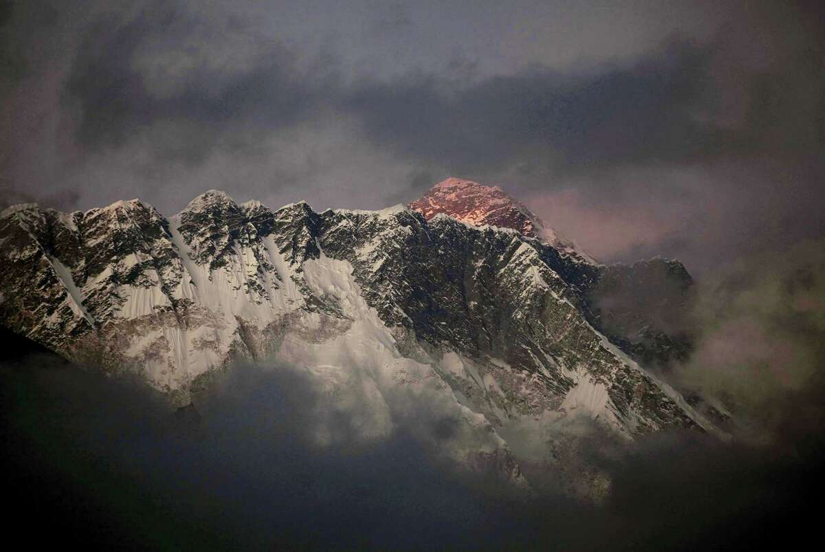 In this Oct. 27, 2011 photo, the last light of the day sets on Mount Everest as it rises behind Mount Nuptse as seen from Tengboche, in the Himalaya's Khumbu region, Nepal. Famed Swiss climber Ueli Steck was killed Sunday, April 30, 2017, in a mountaineering accident near Mount Everest in Nepal, expedition organizers said. Mingma Sherpa of the Seven Summit Treks said Steck was killed at Camp 1 of Mount Nuptse.