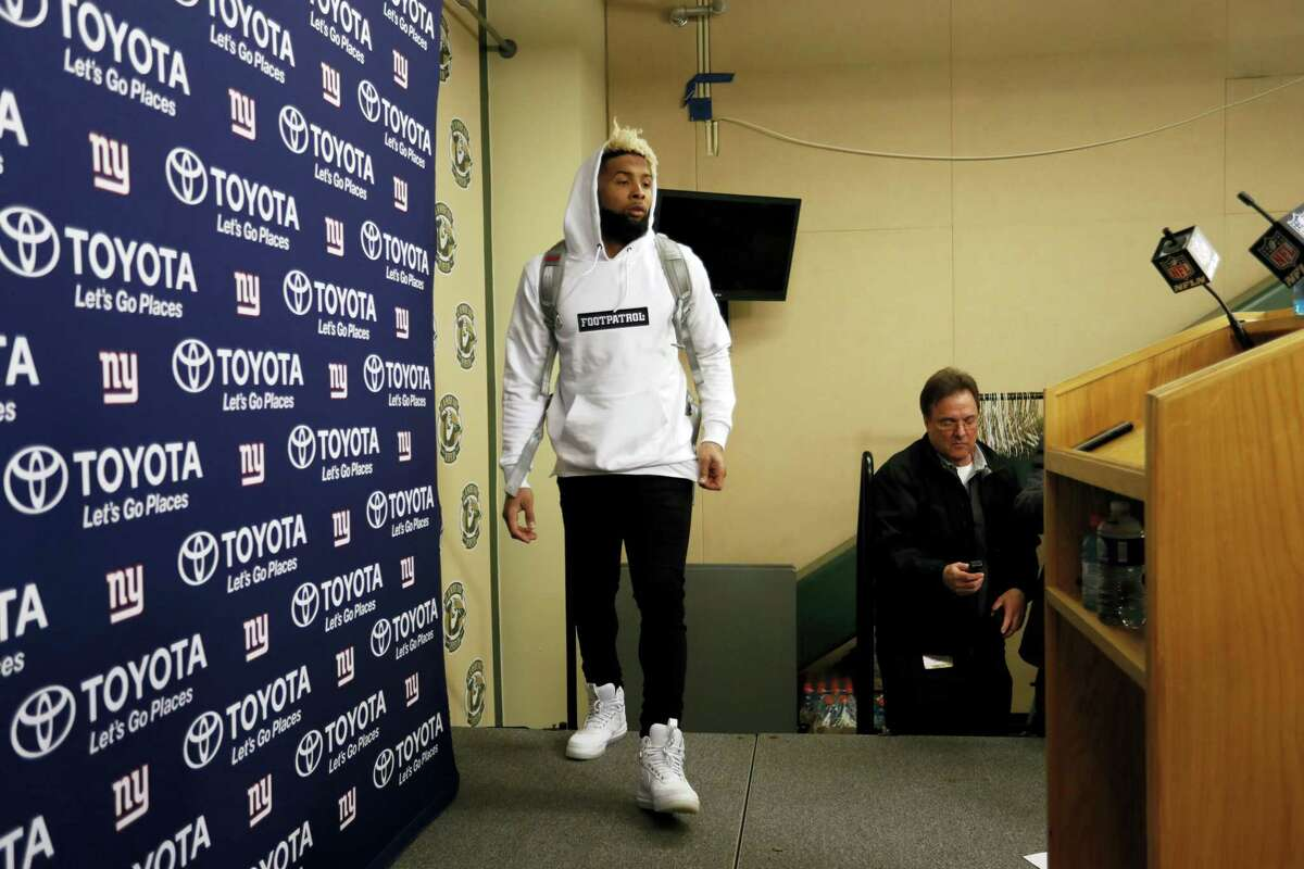 Giants wide receiver Odell Beckham walks up to the podium for a news conference after Sunday's loss to the Packers.