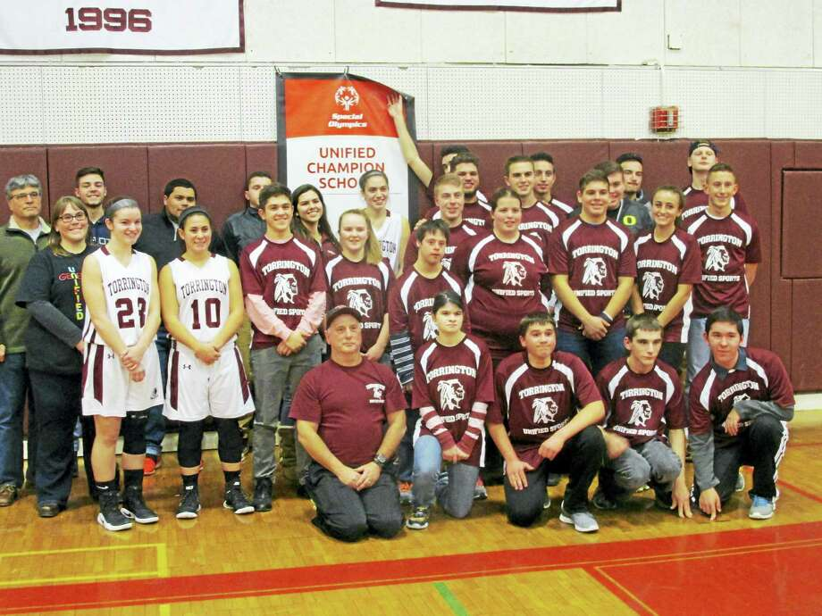 """Torrington's Unified Basketball team and coaches unveil a Unified Champion Banner presented last month at the Unified Leadership Summit in Hartford. CIAC Unified Sports Director George Synott said, """"The Unified program at your school serves as a model not only for Connecticut schools but for high schools throughout the country."""" Photo: Photo By Peter Wallace"""