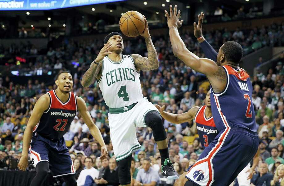 Boston's Isaiah Thomas (4) goes up to shoot against Washington Wizards' John Wall (2) during the first quarter of a second-round NBA playoff series basketball game Sunday in Boston. The Celtics won 123-111. Photo: MICHAEL DWYER - THE ASSOCIATED PRESS  / Copyright 2017 The Associated Press. All rights reserved.