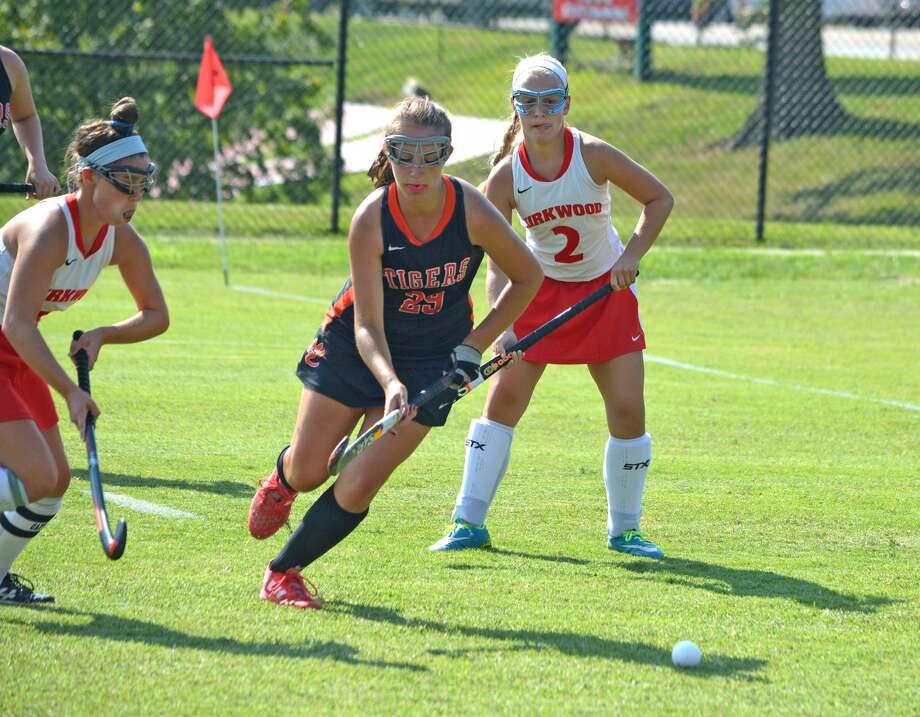 Edwardsville senior Sophia Swalley, middle, works her way past two Kirkwood defenders during Friday's game at Kirkwood.