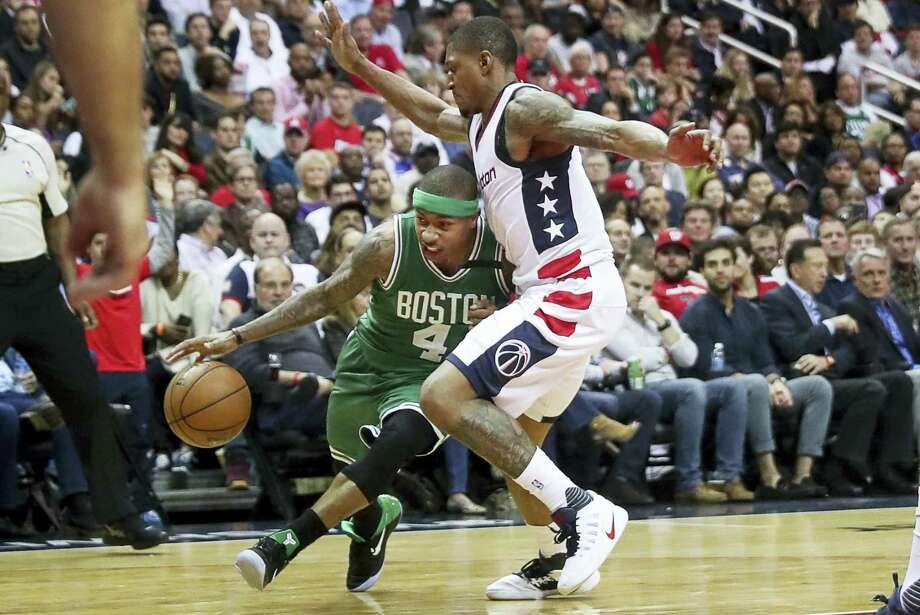 Celtics guard Isaiah Thomas, left, drives on Wizards guard Bradley Beal on Thursday in Washington. Photo: Andrew Harnik — The Associated Press  / Copyright 2017 The Associated Press. All rights reserved.