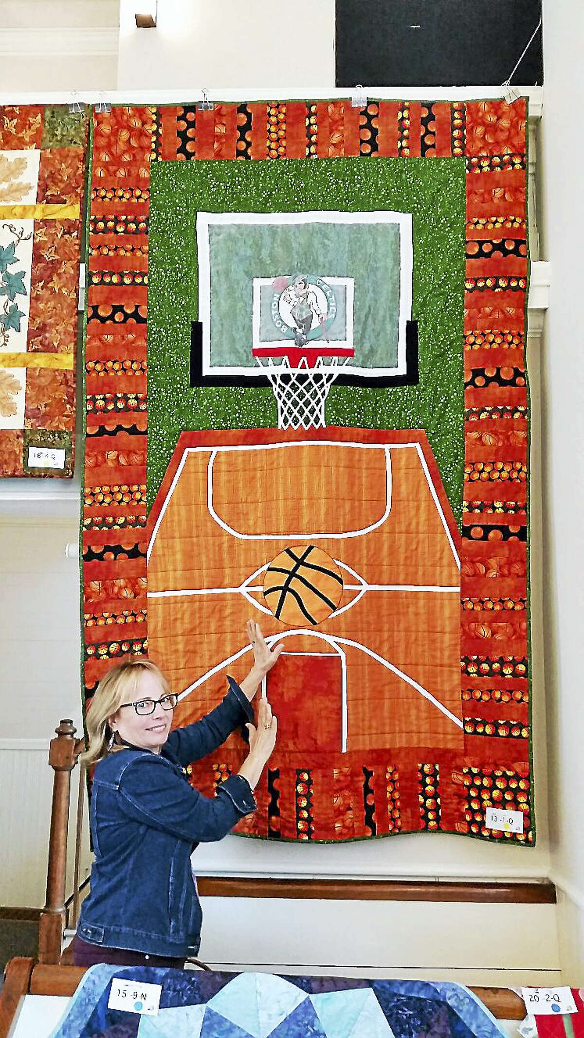 """N.F. Ambery photo Beth Tripp of New Hartford contributed """"Basketball Maniac,"""" a large-scale quilt made with Susan Cane depicting a basketball court made for her grandson."""