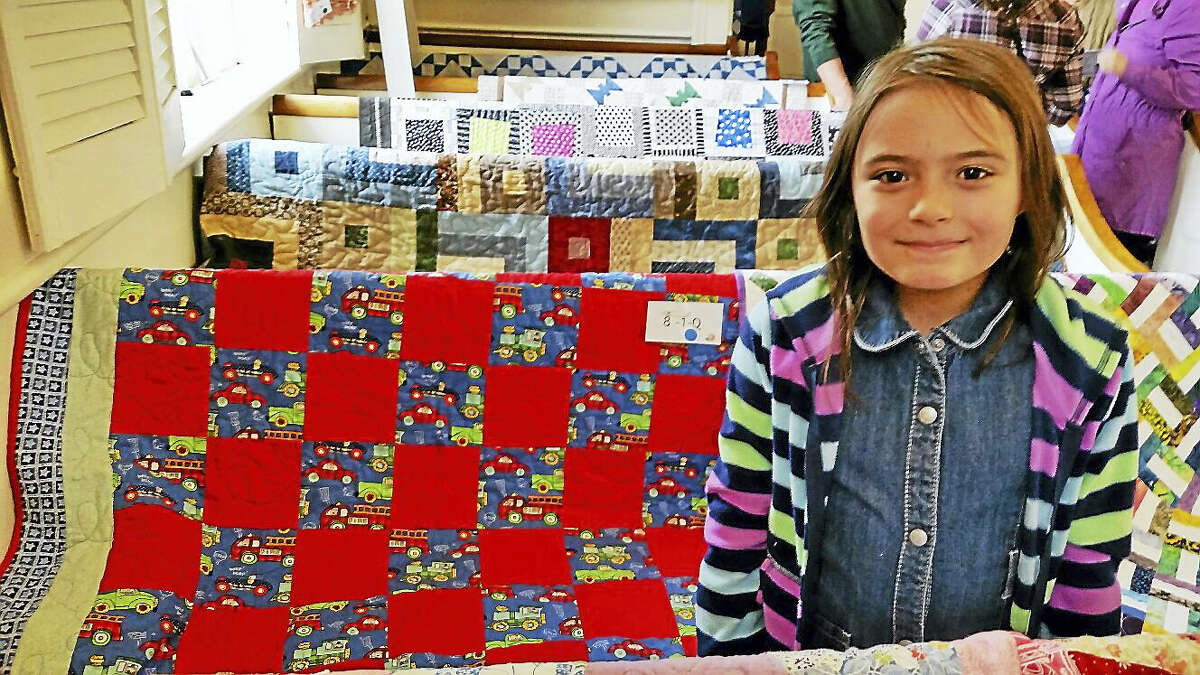 N.F. Ambery photo Mackenzie Strahan, 7, of Winsted was the youngest contributor among the 114 small and large quilts displayed over the weekend at the 10th annual Quilt and Needle Arts Show.