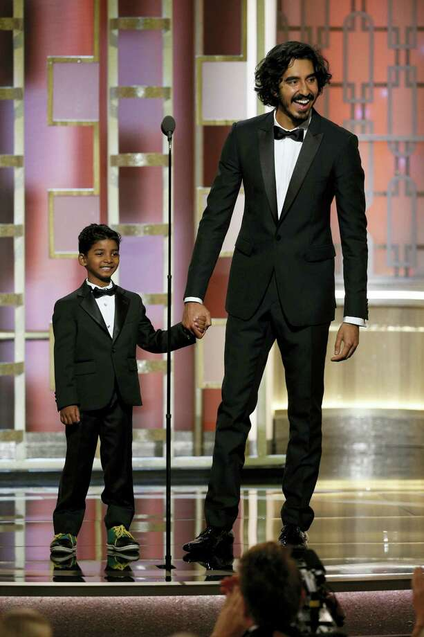 This image released by NBC shows presenters Sunny Pawar, left, and Dev Patel at the 74th Annual Golden Globe Awards at the Beverly Hilton Hotel in Beverly Hills, Calif., on Sunday, Jan. 8, 2017. (Paul Drinkwater/NBC via AP) Photo: Paul Drinkwater/NBC / 2017 NBCUniversal Media, LLC