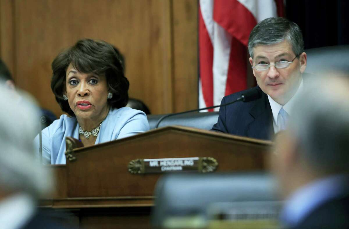 The House Financial Services Committee's ranking member Rep. Maxine Waters D-Calif., left, with committee Chairman Jeb Hensarling, R-Texas, speaks on Capitol Hill in Washington, Tuesday, May 2, 2017, during the committee's hearing on overhauling the nation's financial rules.