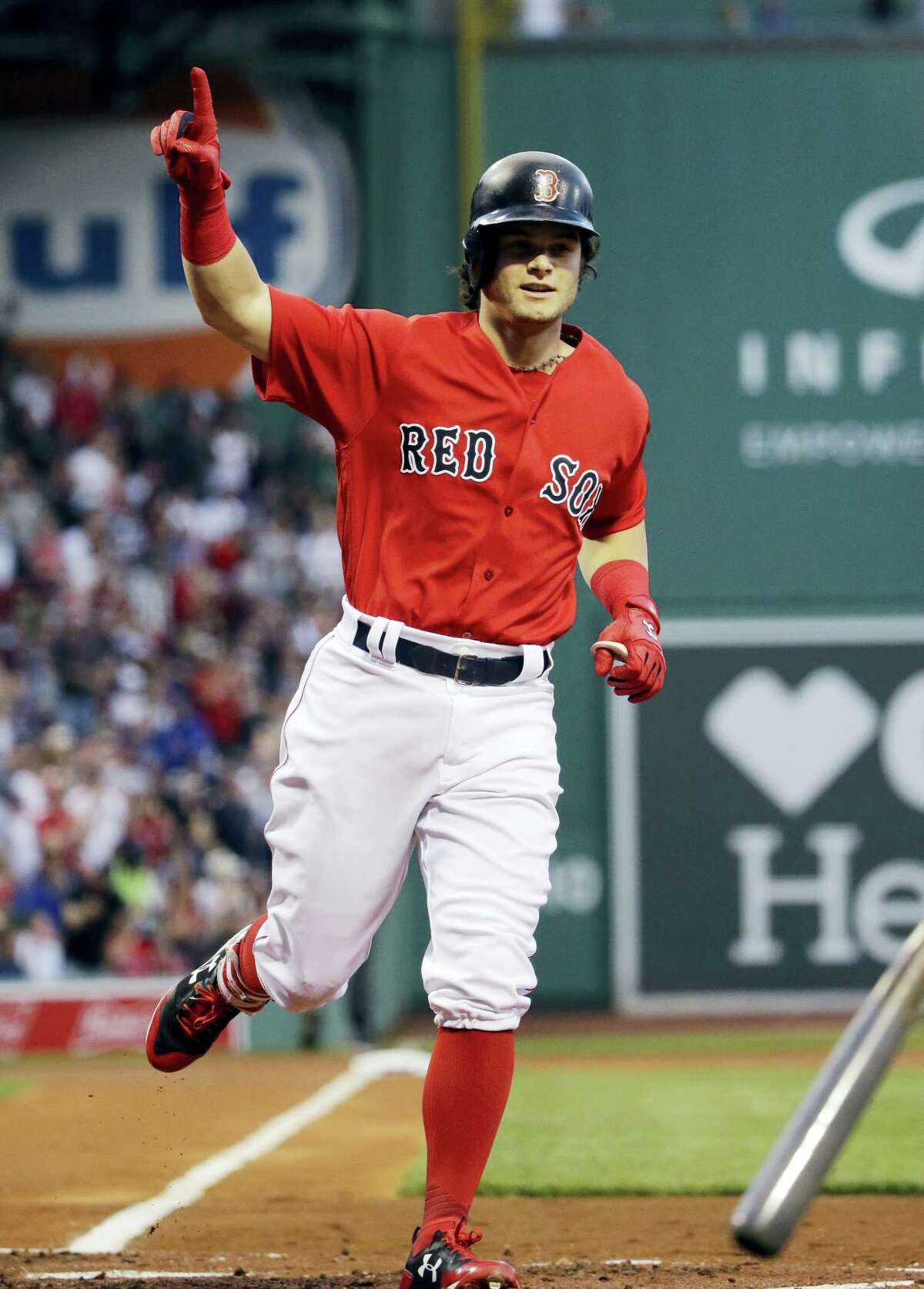 Boston Red Sox's Andrew Benintendi gestures as he crosses the plate with a solo home run during the first inning of the team's baseball game against the Chicago Cubs at Fenway Park, Friday in Boston.