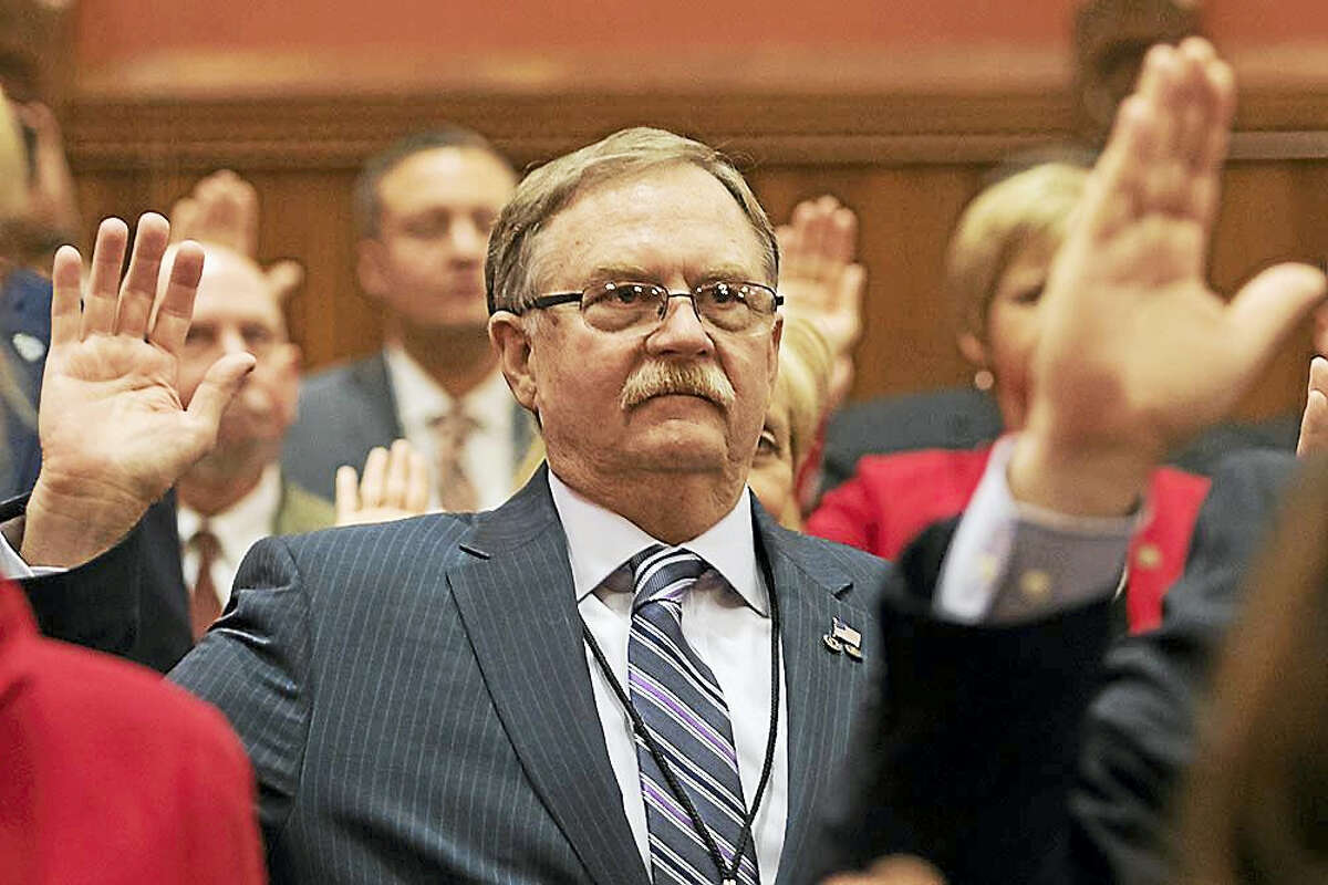 Contributed photoNewly elected state Rep. David Wilson, R-66th, takes the oath of office for his first term.