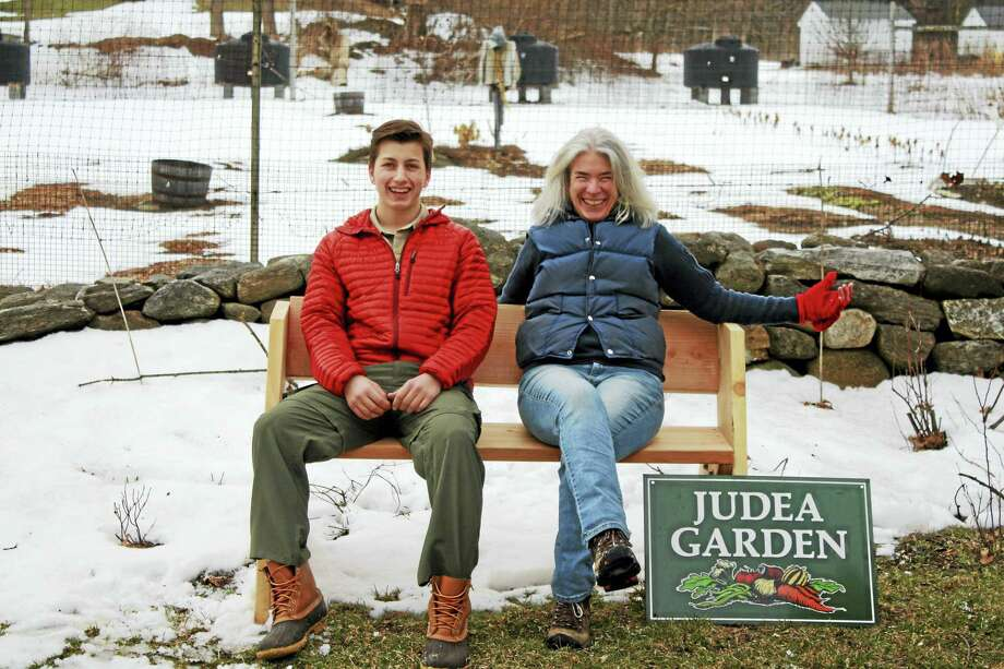Eagle Scout candidate Liam Shannon is joined by Denise Arturi at Judea Garden at the Steep Rock Preserve in Washington Depot, where he and his fellow Troop 29 members built tables and benches for the garden for his Eagle project. Photo: Photos By Holly Shannon