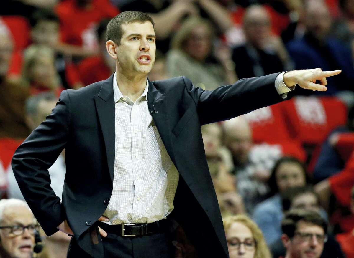 Boston Celtics coach Brad Stevens points up court during the first half in Game 6 of the team's NBA basketball first-round playoff series against the Chicago Bulls, Friday in Chicago.