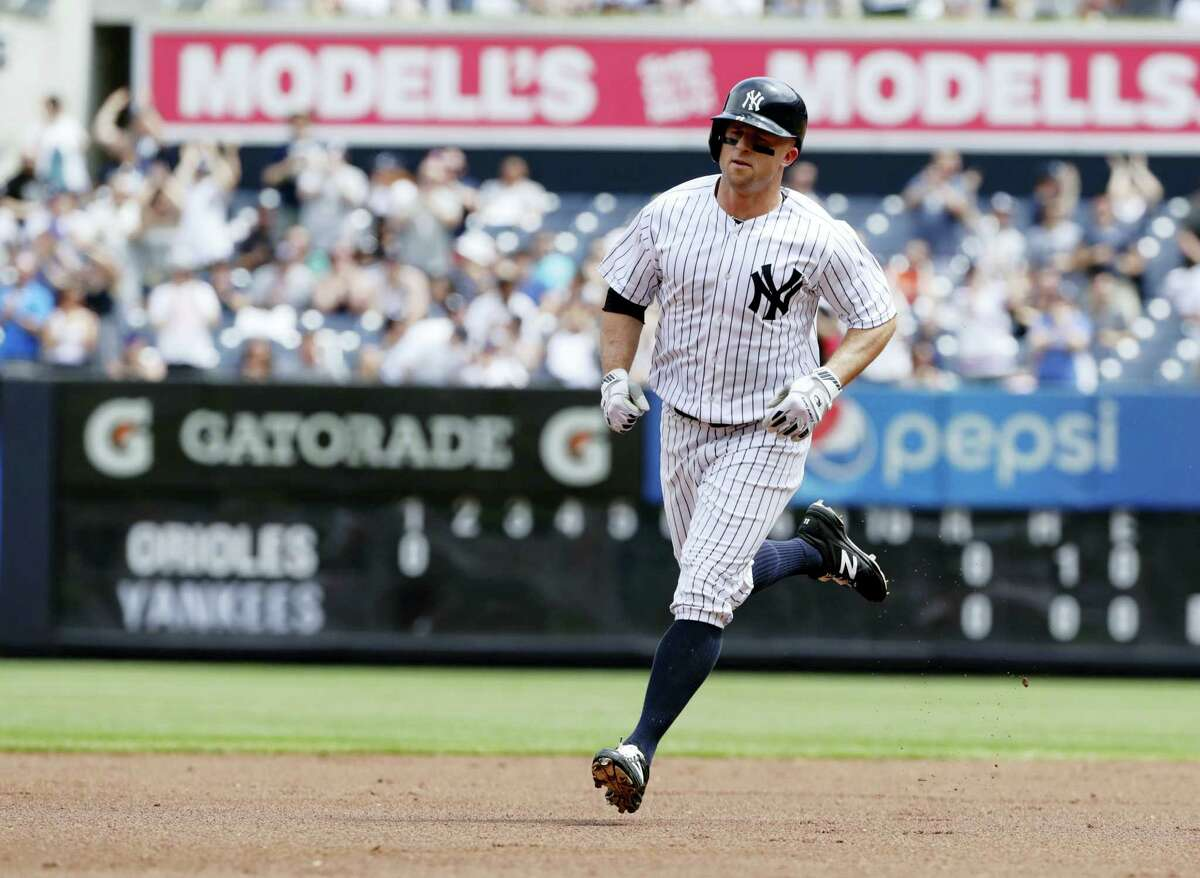 New York Yankees' Brett Gardner runs the bases after hitting a home run during the first inning of a baseball game against the Baltimore Orioles, Saturday in New York.