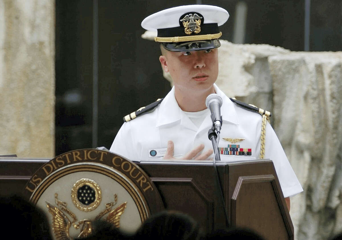 In this Dec. 3, 2008, photo released by the U.S. Navy, Lt. Edward Lin, a native of Taiwan, speaks in the U.S. The U.S. military has charged Lin with espionage for allegedly passing military secrets to China or Taiwan. Lt. Cmdr. Stephanie Turo, a Navy spokeswoman, confirmed on Wednesday, May 3, 2017, the espionage trial in Norfolk will begin Thursday.
