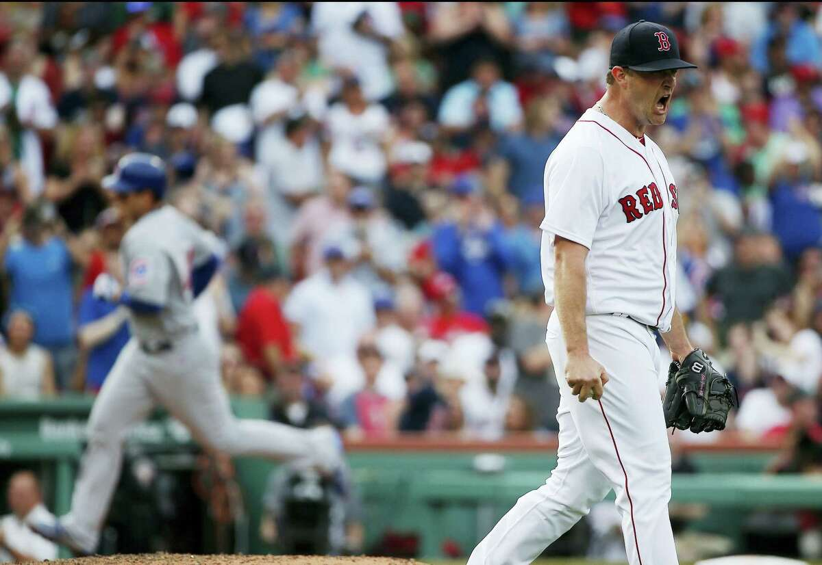 Boston Red Sox's Steven Wright, right, reacts after giving up a two-run home run to Chicago Cubs' Anthony Rizzo, left, during the fourth inning of a baseball game, Saturday in Boston.
