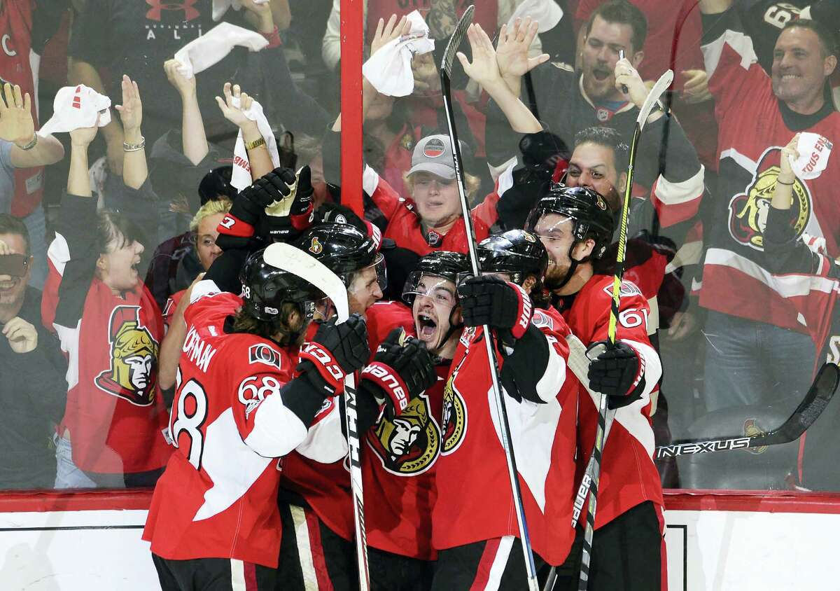 Ottawa Senators center Jean-Gabriel Pageau (44) celebrates his third goal of the game against the New York Rangers with teammates during the third period of Game 2 of an NHL hockey Stanley Cup second-round playoff series Saturday, April 29 2017, in Ottawa, Ontario.
