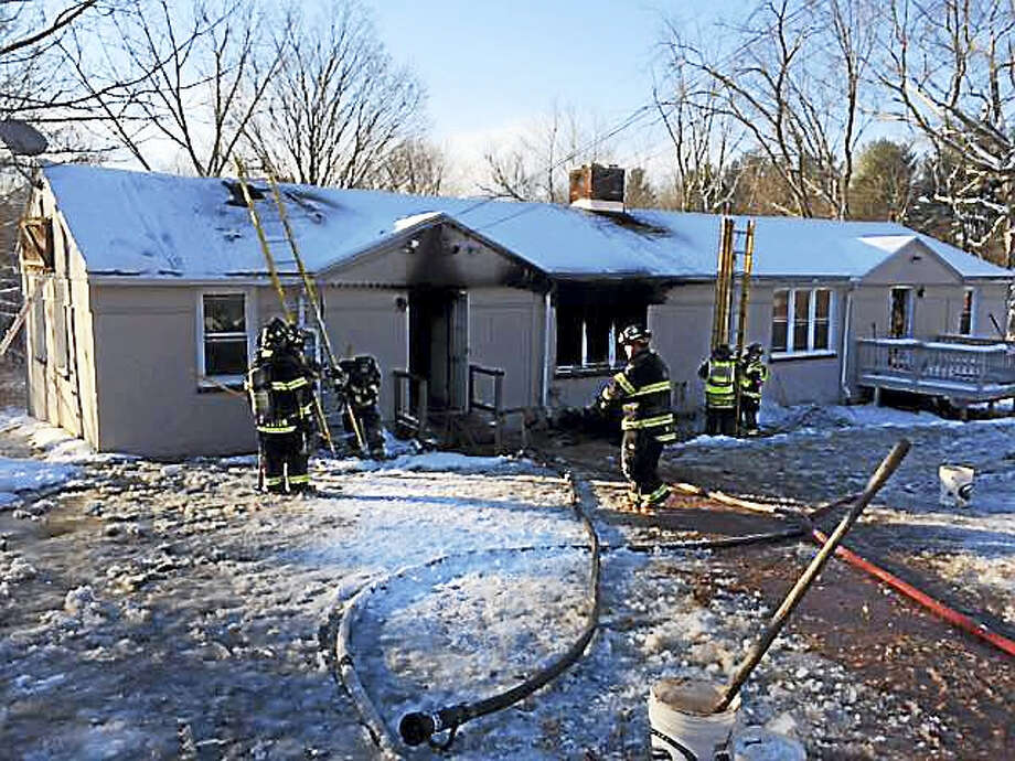 Photos by Cindy FredsallA home was left uninhabitable after firefighters battled a blaze on Burlington Road in Harwinton on Sunday morning. No one was injured. Photo: Digital First Media