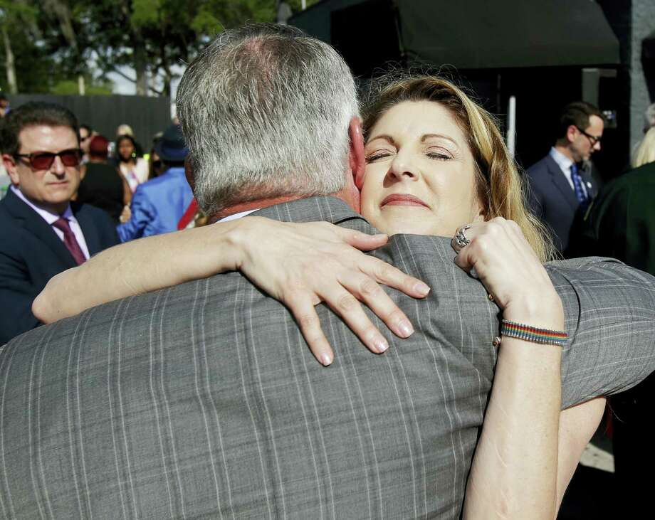 Pulse nightclub owner Barbara Poma, right, embraces Orlando mayor Buddy Dyer after a news conference announcing plans for a memorial at the site, Thursday in Orlando, Fla. Photo: John Raoux — The Associated Press  / Copyright 2017 The Associated Press. All rights reserved.