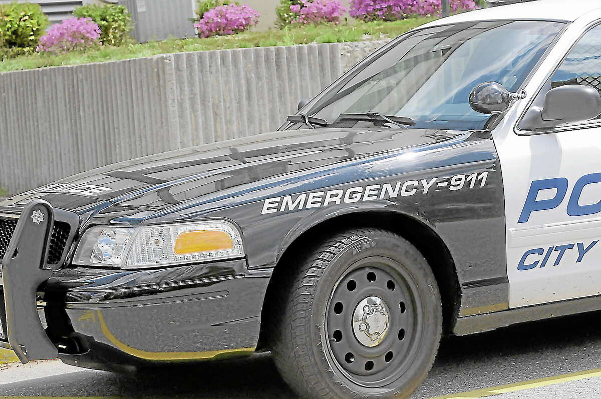 A Torrington Police Department patrol car parked outside Torrington High School on Tuesday, May 14, 2013, a few hours after the school was subject to a drug-sniffing dog search. The school's principal said she hopes the searches turns into a routine for the school. (LAURIE GABOARDI/THE REGISTER CITIZEN)