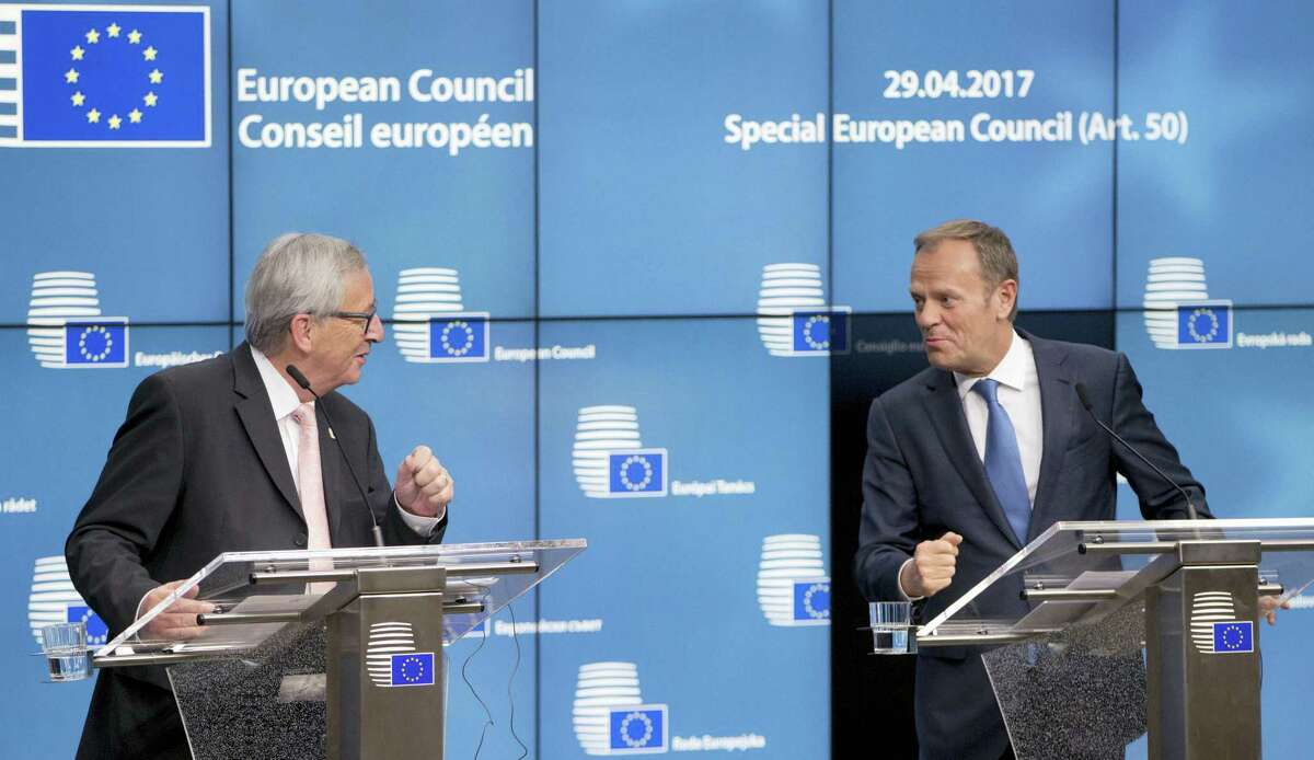 European Commission President Jean-Claude Juncker, left, and European Council President Donald Tusk participate in a media conference at an EU summit in Brussels on Saturday, April 29, 2017. EU leaders met on Saturday for the first time as the formal European Council of 27 to adopt guidelines for the upcoming Brexit negotiations.